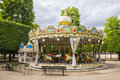 Sweets shoppe and carousel in at the park paris france on a cloudy overcast day this colorful highly ornate old fashioned lit Royalty Free Stock Image