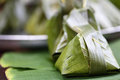 Sweets wrapped in banana leaves Royalty Free Stock Photos