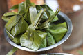Sweets wrapped in banana leaves Stock Photos