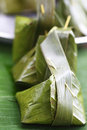 Sweets wrapped in banana leaves Royalty Free Stock Photography