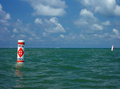 Swim area buoy against expanse of water Royalty Free Stock Photo