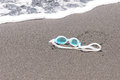 Swim goggles on the sand. Royalty Free Stock Photo
