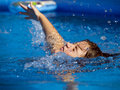 Swim young girl swimming in the pool Stock Photography