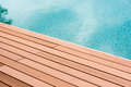 Swiming pool plank on and blue water Stock Image