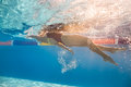 Swimmer in back crawl style underwater Royalty Free Stock Photo