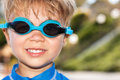 Swimmer boy wearing goggles year old ready to go swimming in the pool he is and smiling Stock Images