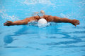 Swimmer close up shot of a young male swimming butterfly stroke shallow focus Stock Image
