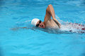 Swimmer close up shot of a young male swimming front crawl stroke Stock Photography