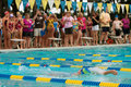Swimmer Does Backstroke As Onlookers Watch Stock Photos
