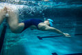 Swimmer female at the swimming pool underwater photo Royalty Free Stock Photos