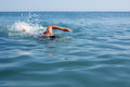 Swimmer floating crawl Royalty Free Stock Photo