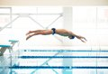 Swimmer jumping from starting block Royalty Free Stock Photo