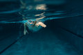 Swimmer male at the swimming pool underwater photo Royalty Free Stock Image