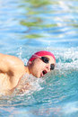 Swimmer man swimming crawl in blue water Stock Images