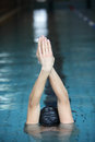 Swimmer raising hands preparing to swim in swimming pool cap Stock Photography