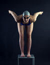 Swimmer at the start of a dark background Royalty Free Stock Photo
