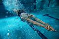 Swimmer at the swimming pool underwater photo Stock Images