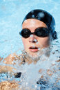 Swimmer in the water with spray Royalty Free Stock Photo