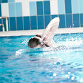 Swimmer woman performing the crawl stroke Royalty Free Stock Photo