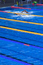 Swimmers in blue pool during training outdoor bright swimming water Royalty Free Stock Image