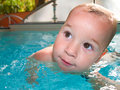 Swimming baby in the pool Stock Images