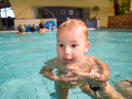 Swimming baby in the pool Stock Photos