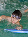 Swimming boy with surf board Royalty Free Stock Photo