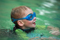 Swimming child close up of the head of a young boy Royalty Free Stock Images