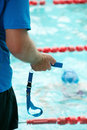 Swimming competition man holding a timer during a Royalty Free Stock Photos