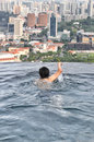 Swimming in the highest swimming pool skypark on top of marina bay sands hotel singapore Royalty Free Stock Photo