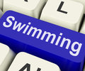 Swimming key means water sport on keyboard meaning Royalty Free Stock Image