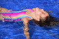 Swimming lessons child learning to float in the water of the pool Stock Photography