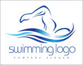 Swimming logo illustration drawing representing a swimmer with water waves swashes around it Stock Image