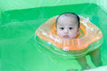 Swimming newborn baby Royalty Free Stock Photo