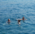 Swimming people in sea water Stock Images