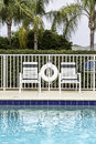 Swimming pool against palms in south florida Stock Photos