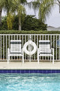 Swimming pool against palms in south florida Stock Photo