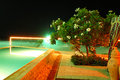Swimming pool and beach of the luxury hotel in night illumination fujairah uae Stock Images