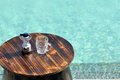 Swimming pool and beer opener and cup Royalty Free Stock Photo