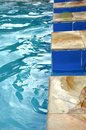 Swimming pool with blue water Royalty Free Stock Photos