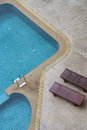 Swimming pool a with couch on a top view Royalty Free Stock Image