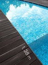 Swimming pool dark wood deck depth marking important safety feature of water markings for with step inside water a photograph Royalty Free Stock Images