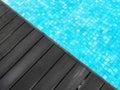 Swimming pool & dark wood deck Royalty Free Stock Photo