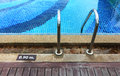 Swimming pool depth marker edge with ladder and Stock Images