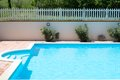 Swimming pool detail of beautiful with plants meadow and fence in the background Royalty Free Stock Photo