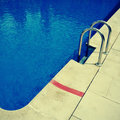 Swimming pool detail of an outdoors in the summer Royalty Free Stock Images
