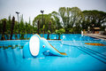 Swimming pool an elephant slide in water Stock Photos