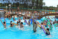 Swimming pool full people having fun playing water aerobic group exercises Stock Photography
