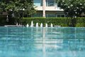 Swimming pool and garden with fountain Stock Images