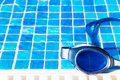 Swimming pool goggles on the poolside part of a Stock Photography